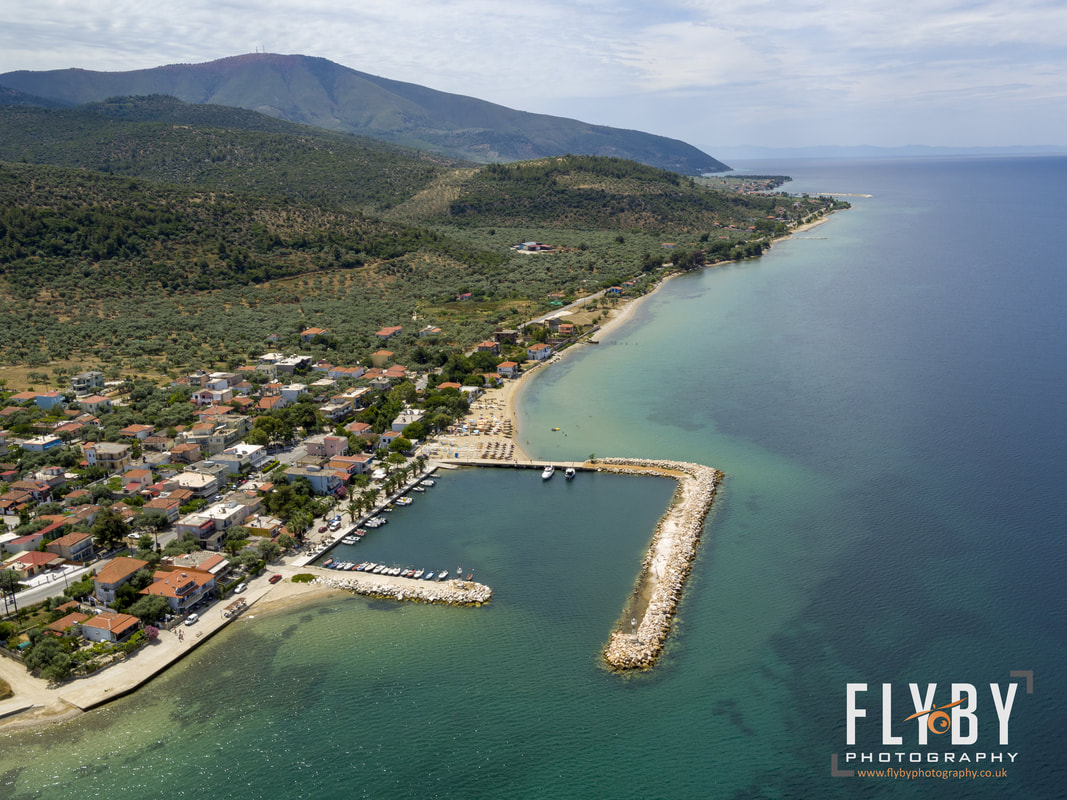 Aerial photo of Skala Sotiros harbor and Thassos island. Drone shot of Thassos Island, Greece