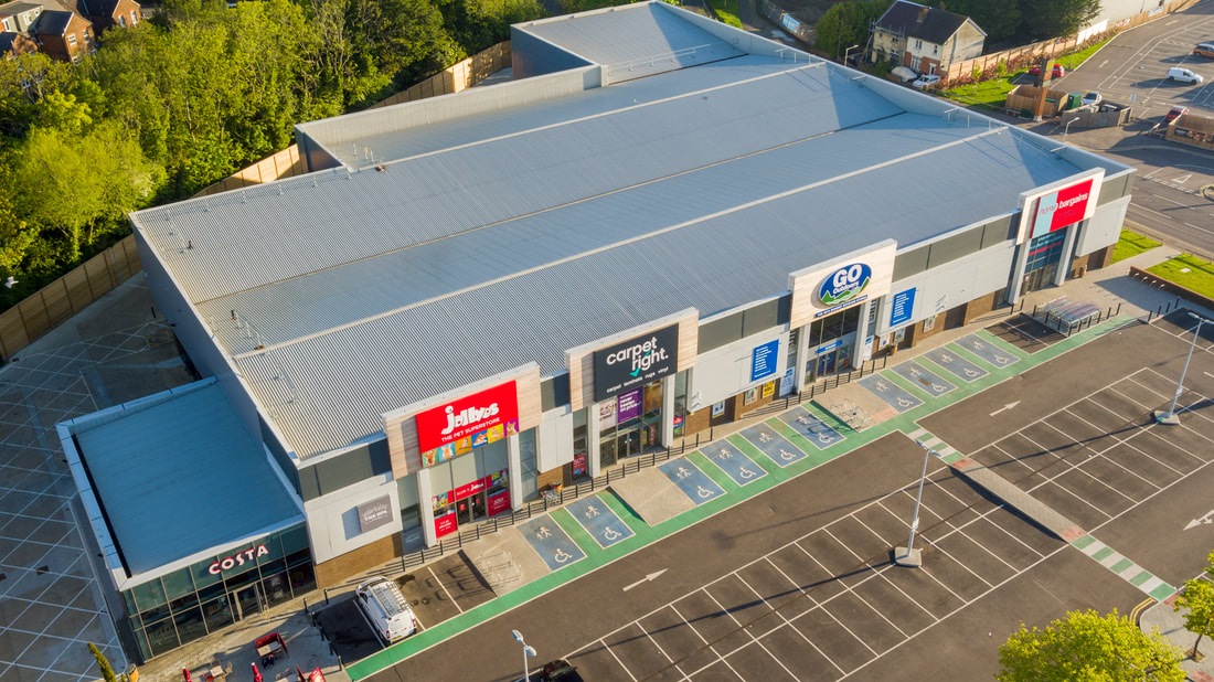 Aerial Photo of Canon Lane Retail Park, Tonbridge. Hire a licensed drone operator with Flyby Photography, aerial photography & Filming experts in Kent & Sussex.